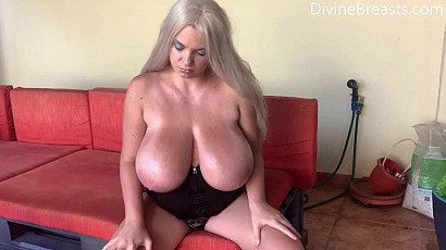 Kitty Puts Baby Oil on Her Huge Breasts