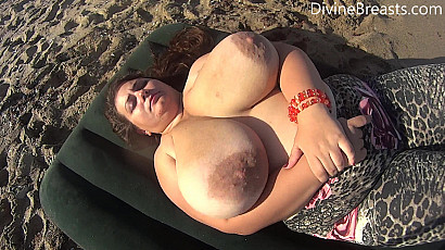 Nina On Back Jiggle Show at the Beach